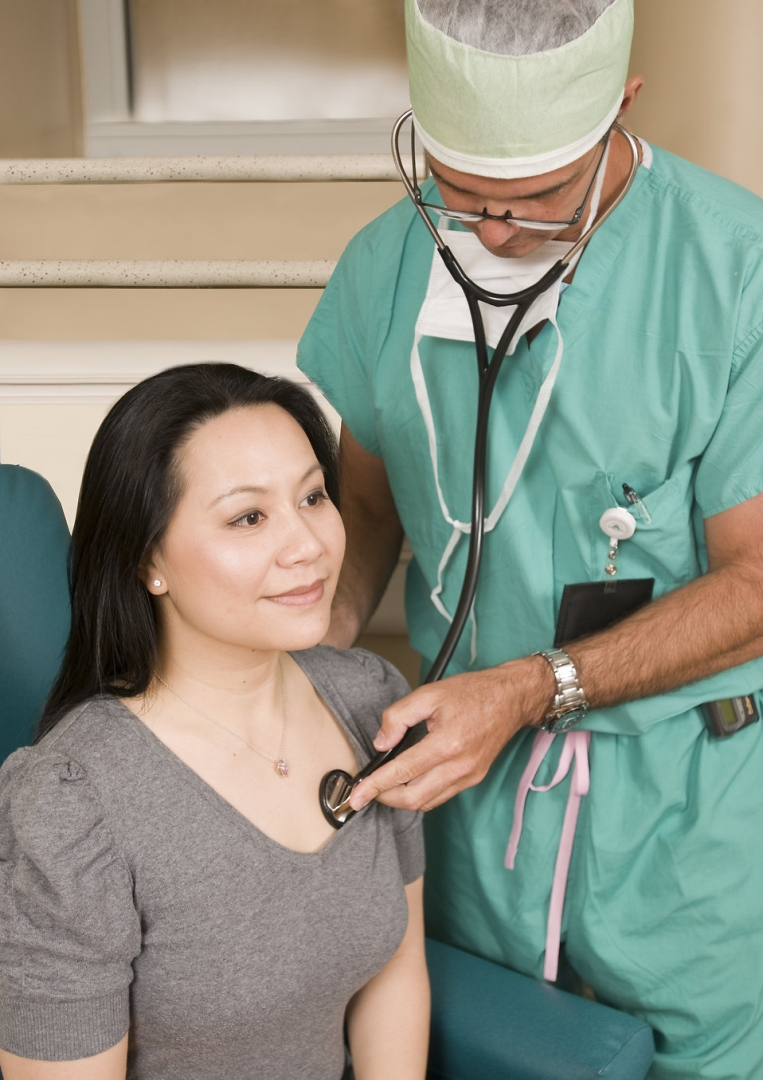 new16381-a-doctor-examining-a-female-patient-pv.jpg