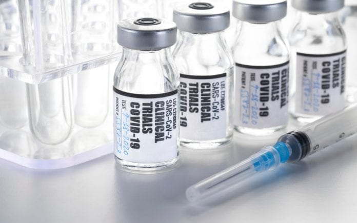 newclinical-trial-vaccine-covid19-coronavirus-in-vial-with-syringe-on-picture-id1215846334-696x435.jpg