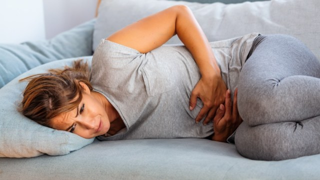 newwoma-stomach-pain-ache-sofa.jpg